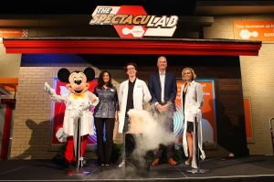 Spectaulab performers posing for grand opening with Mickey mouse.