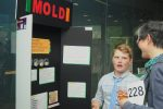 Adult discusses Mold experiment with student.