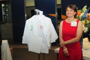 Karlene French poses infront of children's labcoats.