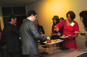 Gala attendees going through buffet line.