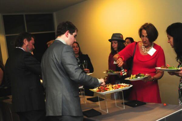 Gala attendees going through buffet line.