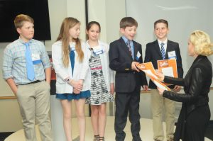 Children receive certificates.