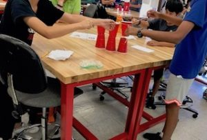 Children participate during cup stacking challenge.