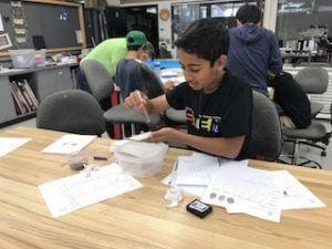Boy uses syringe to test forensic evidence.