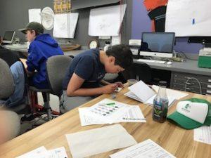 Boy carefully studying forensic evidence.