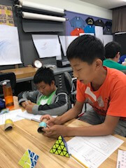 Two boys work together during science lesson.