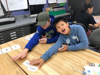 Two boys going through flashcards.