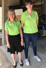 Two instructors wearing lime green Science form Scientists polos.