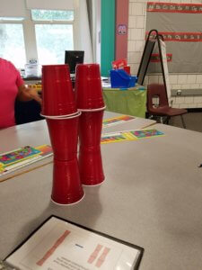 A solo cup structure is shown.