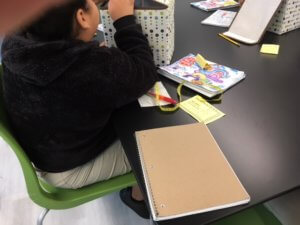 Student opening up a box.