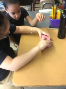 Students work on stacking sponges together.
