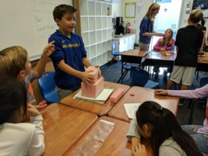 Students stack Foam blocks as part of an investigation for earthquake resistant buildings.