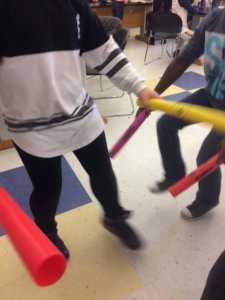 Students use tubes during the Sound lesson