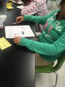Student fills out a worksheet on weather.
