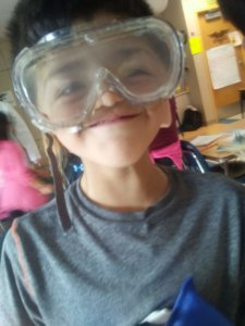 A student wears prism goggles.
