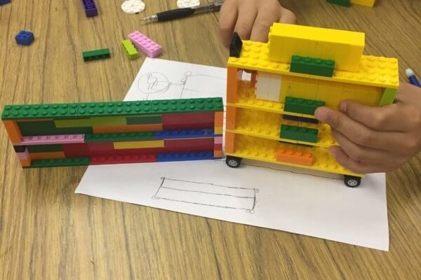 Students redesign a lego bookcase.