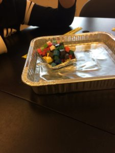 A foil pan in a foil boat holding cubes is shown.