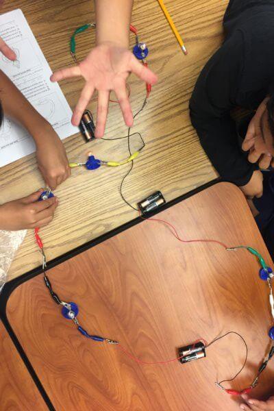 Students create circuits.