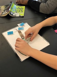 Students add components to their photosynthesis card.