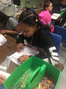 A student looks at her fingerprint worksheet.