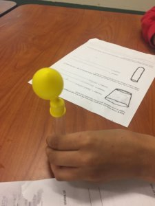 A test tube with a balloon inflating on top of it.