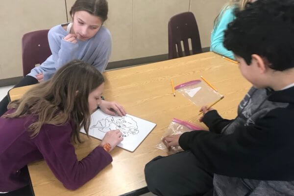 Students fill in a worksheet.