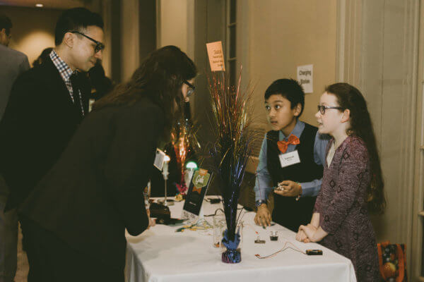 Students talk with guests about SfS lessons at the STEM gala.