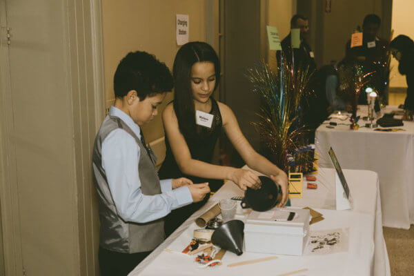 Two students put together the simple machines lesson at the STEM gala.