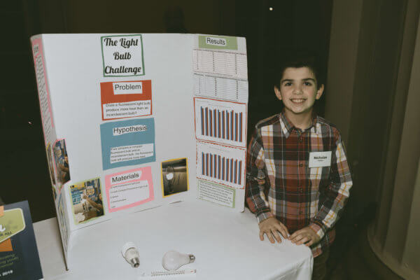 A student with his science fair project at the STEM gala.