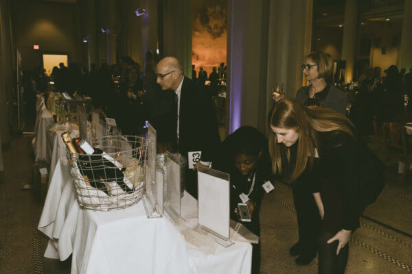 Guests look at the auction items at the STEM gala.