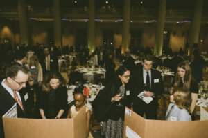 Guests talk with students at the STEM gala.