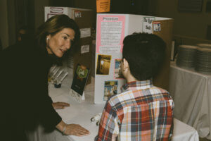 Lt Govenor Karyn Polito talks with student about his science fair project.