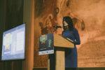 Host Emily Reimer speaks at the podium at the STEM gala.