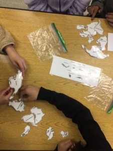 Students put together a Pangea puzzle.