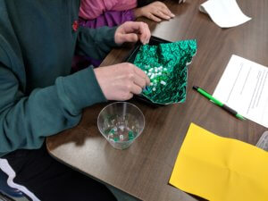 Students collect beads in a hunting game.