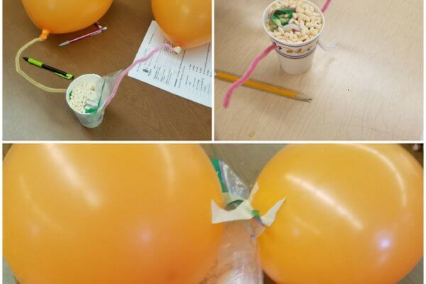 Students create landing apparatus for their egg rover, using paper cups, plastic bags, balloons and cereal.