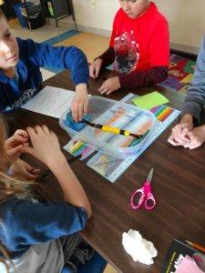 Students construct a model brige.