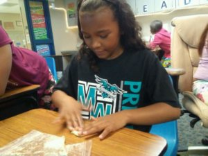 A student works with slime.