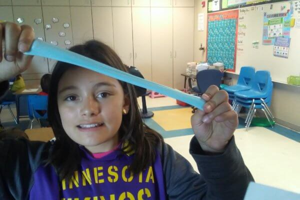 A student stretches a polymer slime.