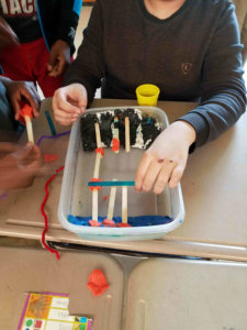 Students build a model bridge.