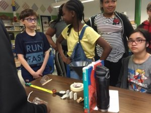 Students build Rube Goldberg devices, learning about simple machines.