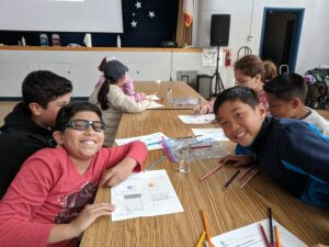 Students investigate the weather with jars of water as models of air masses.