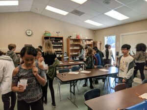 Students travel around the class, modeling the spread of infectious diseases.