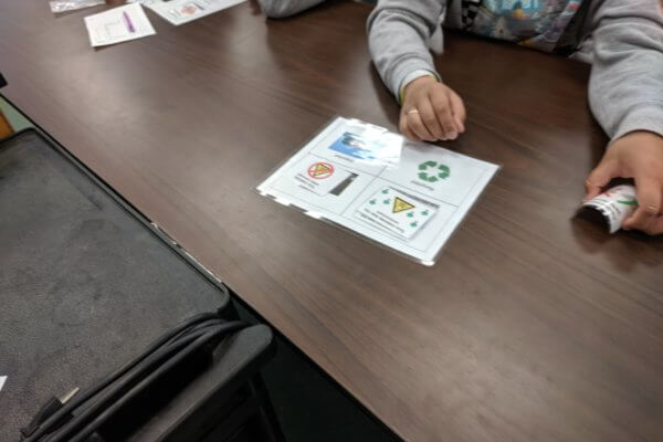 Students look at recycling diagrams.