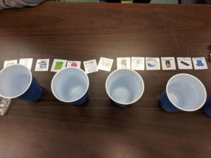 Cups with small cards are shown.