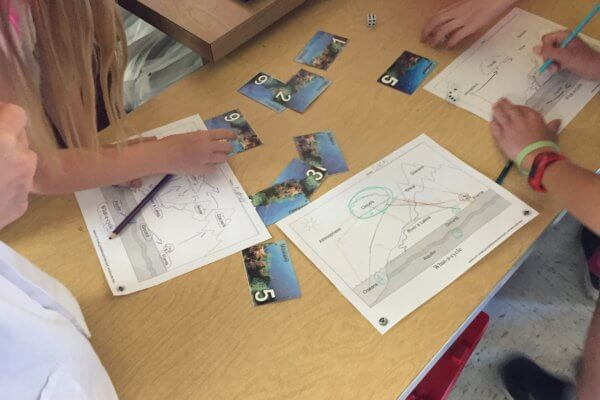 Students visit stations during the water cycle game.