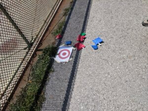 A target on the ground surrounded by beanbags
